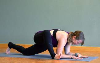 Lizard pose with Leslie Glenn. (facing ground with forearms flat, one leg up).