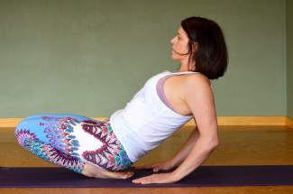 Ankle stretch yoga pose for trail and road runners.