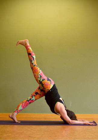 Dolphin pose variation with raised leg for kayakers and rafters.