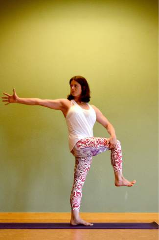 One-legged Mountain with a twist yoga posture for golfers.