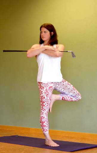 Tree with a twist yoga posture for golfers.