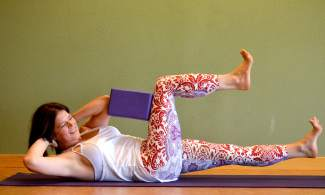 Core with a block yoga posture for golfers.