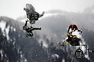 ASPEN, CO - January 26: From left, Joe Parsons and Willie Elam go off the first jump in the bronze medal match of Snowmobile Speed & Style final at Winter X Games Aspen 2013 at Buttermilk Mountain on Jan. 26, 2013, in Aspen, Colorado. The pair finally raced after two false starts for tangling in the first turn. (Photo by Daniel Petty/The Denver Post)