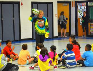 Summit rugby player Cassidy Bargell instructs children on proper rugby technique at Dillon Valley Elementary school in May. Each clinic was held in coordination with the CATCH afterschool program and with the support of the Summit Lake Dillon Optimists.