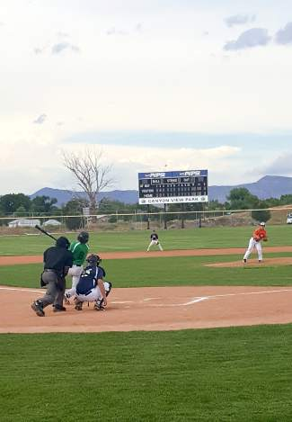 A Summit player pops up during the first-annual Mountain West Summer Collegiate Baseball League All-Star Game, played in Grand Junction on July 2. Players from all six league teams came together for the event. Summit and the East won, beating the West 6-2.