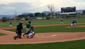 A Summit player knocks a single during the first-annual Mountain West Summer Collegiate Baseball League All-Star Game, played in Grand Junction on July 2. The East team, including several Summit players, beat the West team by 6-2.