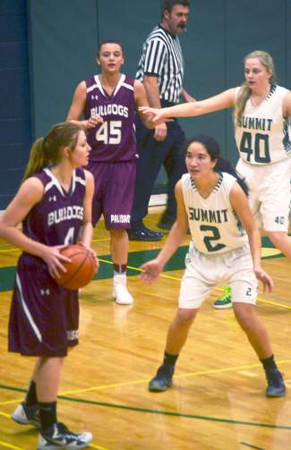 Summit's Jess Horii (2) and Autumn Ward (40) guard Palisade players during a home basketball game on Feb. 6. The Lady Tigers lost, 17-33.