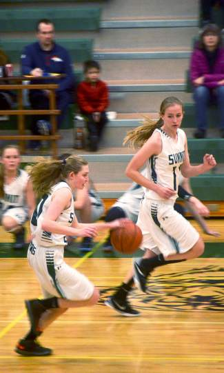 Summit's Kate Tomlinson (10) and Megan McDonnell (11) drive up the court during a home basketball game against Palisade on Feb. 6. The Lady Tigers lost, 17-33.