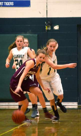 Summit's Megan McDonnell (11) and Haleigh Lecklitner (23) battle a Palisade forward for the ball during a home basketball game on Feb. 6. The Lady Tigers lost, 17-33.