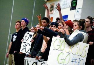 Summit students cheer the boy's basketball team during a home match in early January. Despite a slow start to the season (1-2 in the league), the Tigers still have a chance to make the conference tournament in February if they get above .500 and stay there.