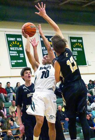 Summit's Jesus Moya (10) goes up for a shot as Battle Mountain's Creek Kamby (13) defends during the first half of a home basketball game on Jan. 12. The Tigers lost, 54-72.