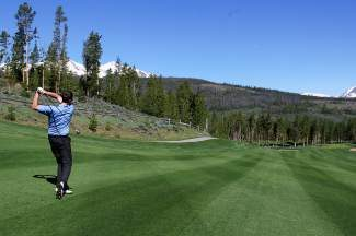 A golfer targets the green on hole-2 of the Bear Course at Breckenridge Golf Club. Properly navigating a course and accounting for one's limitations is equally as important as simply striking the ball, and frequently a neglected skill among golfers.