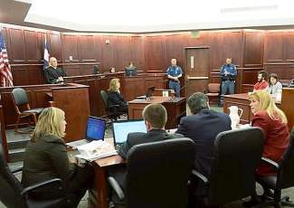 CENTENNIAL, CO-March 12, 2013: Prosecutor Karen Pearson, dressed in red suit, and the prosecution team at their table during the proceedings where District Court Judge William Sylvester entered a Not Guilty plea on behalf of Holmes. The trial is set to begin August 5, 2013. The arraignment for Aurora theater shooting suspect James Holmes for the July 20, 2012 shooting at the Century 16 theater in Aurora, CO that killed 12 people and injured 70 others. (Photo By RJ Sangosti/The Denver Post)