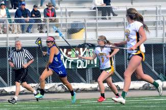 Summit defenders chase down a Fruita attacker during a home varsity lacrosse game on April 22. The Tigers lost, 7-12.