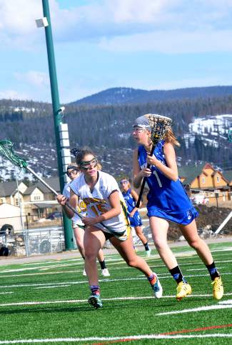Shut down in the backfield: Summit's Abigail Hiller (15) stops a Fruita attack during a varsity lacrosse game at home last weekend, shot by @sumcosports