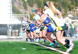 Summit and Fruita lacrosse players line up for the face-off at a varsity game at Summit High School on April 22. The Tigers lost, 7-12.