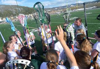 The Tigers varsity lacrosse team chants after a home varsity game against Fruita on April 22. The Tigers lost, 7-12.