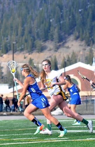 Summit's Katelyn Keen chases down a Fruita attacker during a home varsity lacrosse game on April 22. The Tigers lost, 7-12.