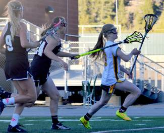 Summit junior Kenady Nevicosi blasts past Grand Junction defenders en route to scoring one of four goals during the Lady Tigers 7-10 loss at home on May 3.