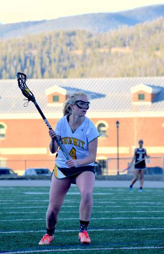 Summit senior Elle Scott-Williams searches for an open teammate at the final home soccer game of the girl's lacrosse season against Grand Junction on May 3. The Tigers lost at home, 7-10.