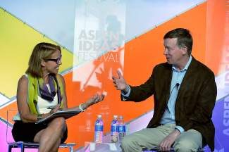 Katie Couric and Colo. Gov. John Hickenlooper share a laugh during an Aspen Ideas session titled, 'What's the Dope on Pot?'