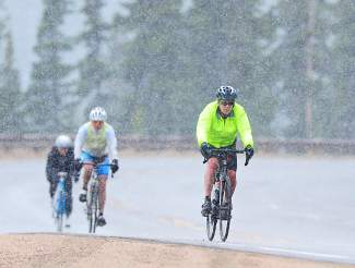 Ride the Rockies participants brave cold and wet conditions to descend Berthoud Pass at the 2014 bike tour. The annual event returns to Summit County and the Central Rockies again this summer from June 11-17 for six days and 400 miles of cycling.