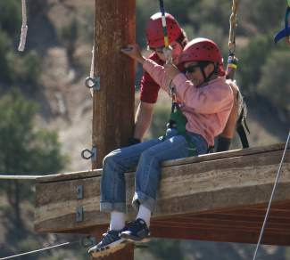Xavier Ciccone is strapped in and ready for the zipline at Roundup River Ranch.