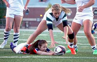 A Summit High School player goes after a loose ball during a rugby match with Chaparral in late September. The Tigers won 66-12 in what's hopefully a preview of the rugby State Championship match against Chaparral in Devner on Nov. 14, shot by @louietraub