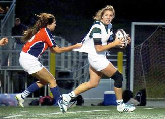 Summit High School's Meg Rose, right, looks for a teammate to pass to before being taken down by a Chaparral defender during a Tigers home rugby match in late September. The Tigers take on Chaparral in the rugby State Championship in Denver on Nov. 14, shot by @louietraub