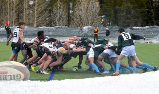 The Summit and Palmer rugby teams set up for a scrum in the first half of a high school club rugby game at Kingdom Park in Breckenridge on March 12. The brand-new Summit team is still learning the basics of the sport this season with hopes of dominating several years down the road.