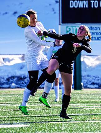 Summit's Tanner McCann (left) battles for the ball with Battle Mountain's Skye Whitney during the Tigers first home soccer match of the season. The Tigers lost, 2-4.