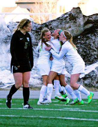 The Summit girl's varsity soccer team celebrates after scoring a goal at home against Battle Mountain on March 10. The Tigers lost the game, 2-4.