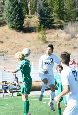 Summit forward Gerson Martinez (8) goes up for a header against a Delta player in the first half of a varsity soccer game at home on Oct. 17. The Tigers won 1-0.