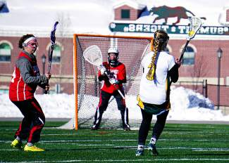 Wait for it...: Tigers sophomore Erin Scott-Williams pauses a split second for an open shot against Durango on March 18, boosting the girl's lacrosse team to a 12-8 win and its second win of the season, captured by @louietraub