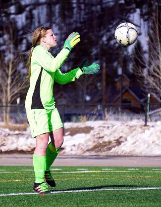 Summit senior keeper Lexi VanderHoeven gobbles up the ball during the Tigers 0-0 draw against Eagle Valley on March 22.