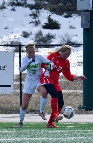 Summit's Haleigh Lecklitner (3) battles for the ball with a Glenwood Springs defender in the second half of a home varsity soccer game on April 26. The Tigers lost, 0-3.