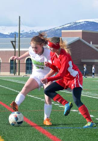Summit freshman defender Syd Frolik boxes out a Glenwood Springs forward during a home varsity soccer game on April 26. The Tigers lost, 0-3.