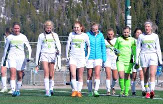 The Summit High School girl's varsity soccer team walks across the field between halves during a home match against Glenwood Springs on April 26. The Tigers lost, 0-3.