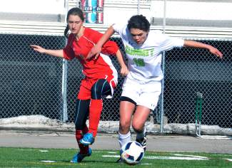 Beating the Demon: Summit's Gisele Thompson (16) runs past a Glenwood Springs midfielder during a home varsity soccer game earlier this week, captured by @sumcosports
