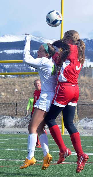 Summit's Shannon Hogeman (8) goes up for a header with a Glenwood Springs defender on her back during a home varsity soccer game on April 26. The Tigers lost, 0-3.