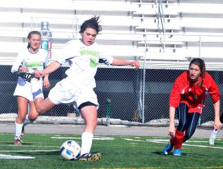 Summit sophomore midfielder Gisele Thompson (16) winds up for a boot downfield during a home varsity soccer game against Glenwood Springs on April 26. The Tigers lost, 0-3.