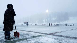 #TBT to LAX snow: Summit High athletic director Amy Raymond waits for a boy's lacrosse game to continue after clearing the field during a blizzard game in late March, shot by @sumcosports