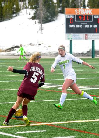 Summit's Katie Sullivan pressures Palisade's Ali Bollinger during the second half of a home girl's soccer game on March 12. The Tigers lost, 0-2.