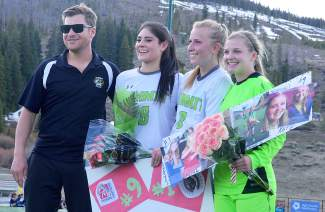 For the final home game, Summit girl's head coach Tommy Gogolen (left) said a few words about his three graduating seniors (from left): Paloma Arredondo, Katie Sullivan and Lexi Vanderhoeven. Sullivan and Vanderhoeven had one goal apiece at the Tigers 3-2 win against Rifle on May 3.