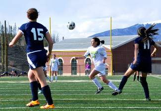 Summit sophomore Gisele Thompson charges for the ball after a Rifle goal kick during the final home game of the season against Rifle on May 5, shot by @sumcosports
