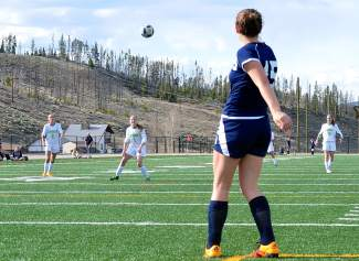 Summit's Lexi Vanderhoeven (1) waits to take the ball on a goal kick during the final girl's soccer game of the season against Rifle on May 5. The Tigers won, 3-2.