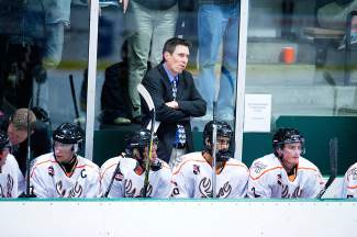 Breck Bucks head coach Jesse Davis watches the ice at his team's first home stand Oct. 3-4. Since losing the opener, the Bucks have improved to 8-3 on the season.