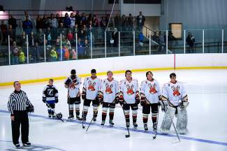 The Breck Bucks lined up for the national anthem at their season opener on Oct. 3, shot by Eban Bell.