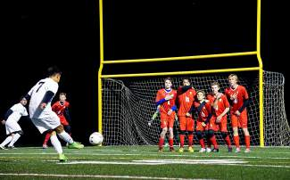Summit's Omar Espinoza (7) takes a free kick at the Steamboat Springs defense on Oct. 6, shot by @louietraub