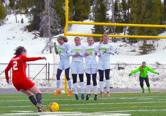 Strength in numbers: A string of Summit defenders forms a wall to block a free kick during a varsity soccer game against Steamboat Springs on March 29, shot by @sumcosports